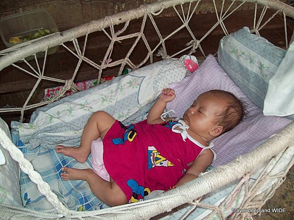 filipino baby rocking making a difference  the philippines   travel deep and widetravel      rh   traveldeepandwide